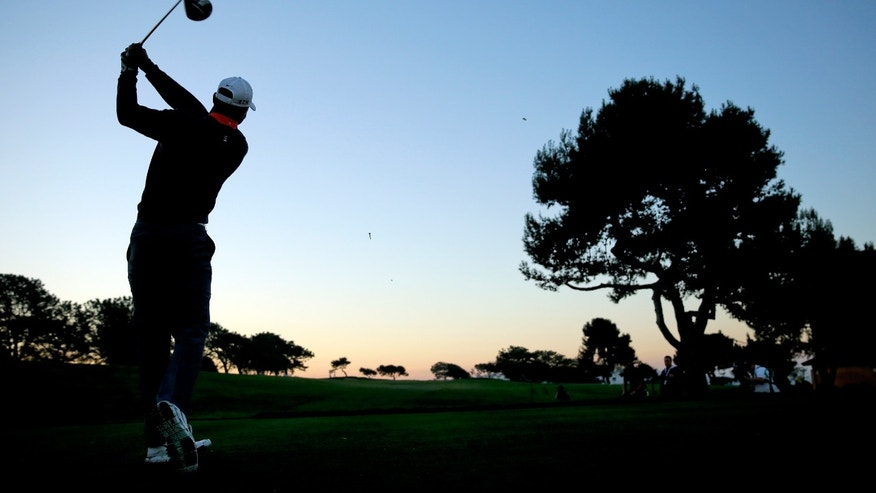 Tiger Woods tees off on the second hole during the pro-am at the Farmers Insurance Open golf tournament at Torrey Pines Golf Course on Wednesday, Jan. 22, 2014, in San Diego. (AP Photo/Chris Carlson)
