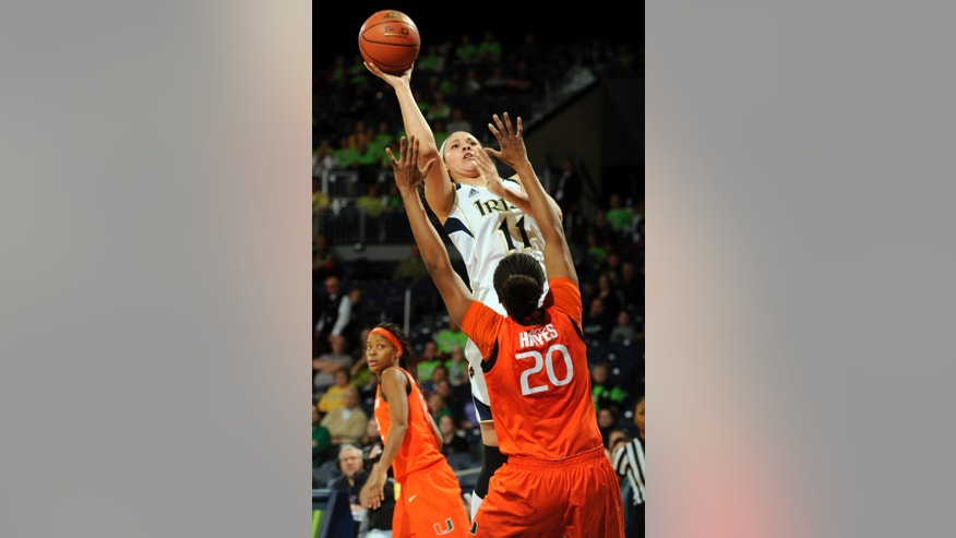Notre Dame forward Natalie Achonwa puts a shot up over Miami forward Keyona Hayes during the first half of an NCAA college basketball game, Thursday, Jan. 23, 2014 in South Bend, Ind. (AP Photo/Joe Raymond)