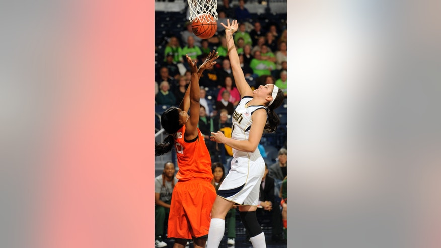 Notre Dame forward Natalie Achonwa, right, puts a shot up as Miami guard Nicole Sterling defends during the first half of an NCAA college basketball game, Thursday, Jan. 23, 2014 in South Bend, Ind. (AP Photo/Joe Raymond)