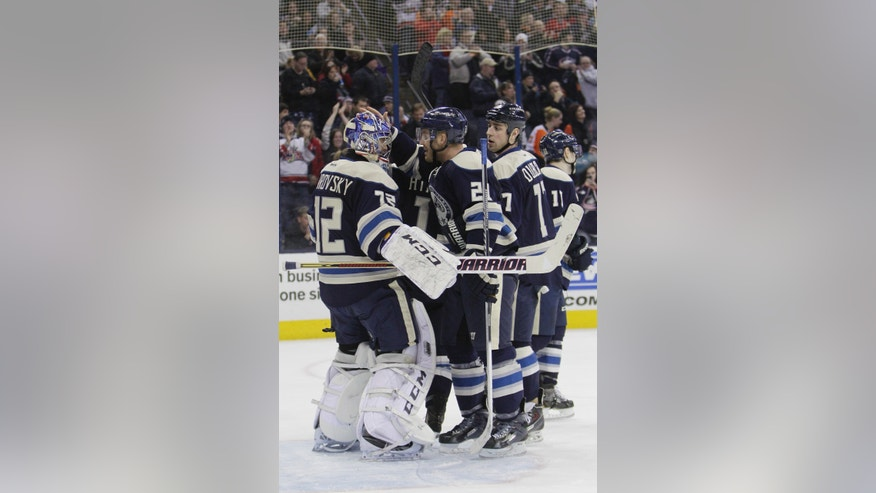 Columbus Blue Jackets goalie Sergei Bobrovsky, left, of Russia, is congratulated after beating the Philadelphia Flyers in an NHL hockey game Thursday, Jan. 23, 2014, in Columbus, Ohio. The Blue Jackets extended their franchise record winning streak to eight games with a 5-2 win over the Flyers. (AP Photo/Jay LaPrete)