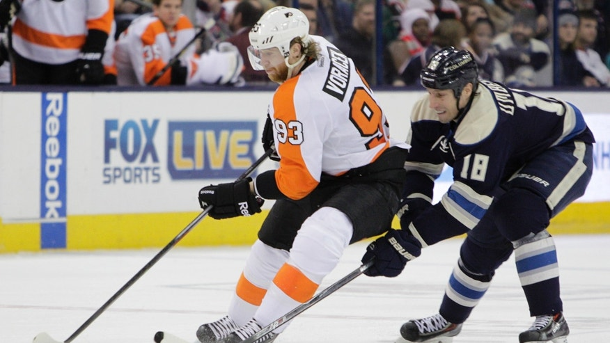 Philadelphia Flyers' Jakub Voracek, left, of the Czech Republic, carries the puck across the blue line as Columbus Blue Jackets' RJ Umberger defends during the third period of an NHL hockey game Thursday, Jan. 23, 2014, in Columbus, Ohio. The Blue Jackets beat the Flyers 5-2. (AP Photo/Jay LaPrete)