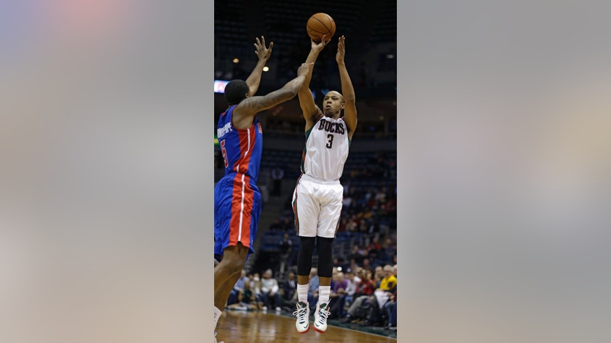 Milwaukee Bucks' Caron Butler(3) shoots against Detroit Pistons' Kentavious Caldwell-Pope, left, during the second half of an NBA basketball game Wednesday, Jan. 22, 2014, in Milwaukee. The Bucks won 104-101 and Butler scored 30 points. (AP Photo/Jeffrey Phelps)