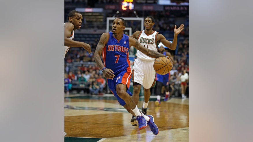 Detroit Pistons' Brandon Jennings (7) drives against Milwaukee Bucks' Khris Middleton, left, during the first half of an NBA basketball game Wednesday, Jan. 22, 2014, in Milwaukee. (AP Photo/Jeffrey Phelps)