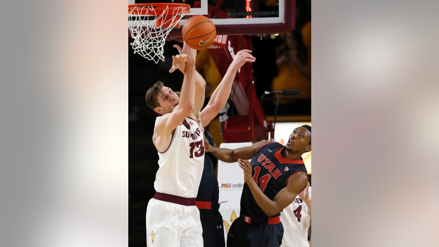 Arizona State's Jordan Bachynski (13) battles for a loose ball with Utah's Dallin Bachynski, back, as Utah's Dakarai Tucker (14) looks on during the first half of an NCAA basketball game Thursday, Jan. 23, 2014, in Tempe, Ariz. (AP Photo/Ross D. Franklin)