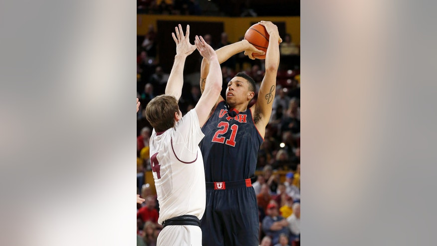 Utah's Jordan Loveridge (21) puts up a shot over Arizona State's Bo Barnes (4) during the first half of an NCAA basketball game Thursday, Jan. 23, 2014, in Tempe, Ariz. (AP Photo/Ross D. Franklin)