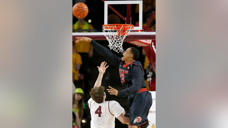 Utah's Princeton Onwas (3) blocks the shot of Arizona State's Bo Barnes (4) during the first half of an NCAA basketball game Thursday, Jan. 23, 2014, in Tempe, Ariz. (AP Photo/Ross D. Franklin)