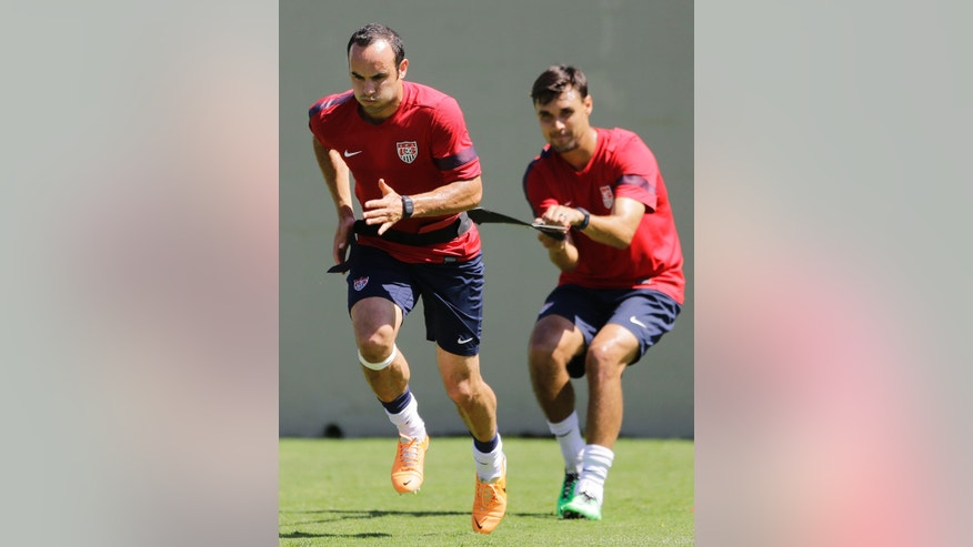 United States' Landon Donovan, left, and teammate Chris Wondolowski train in Sao Paulo, Brazil, Wednesday, Jan. 22, 2014. The US national soccer team is on a training program in Sao Paulo preparing for the World Cup tournament, which gets underway in June.  (AP Photo/Nelson Antoine)