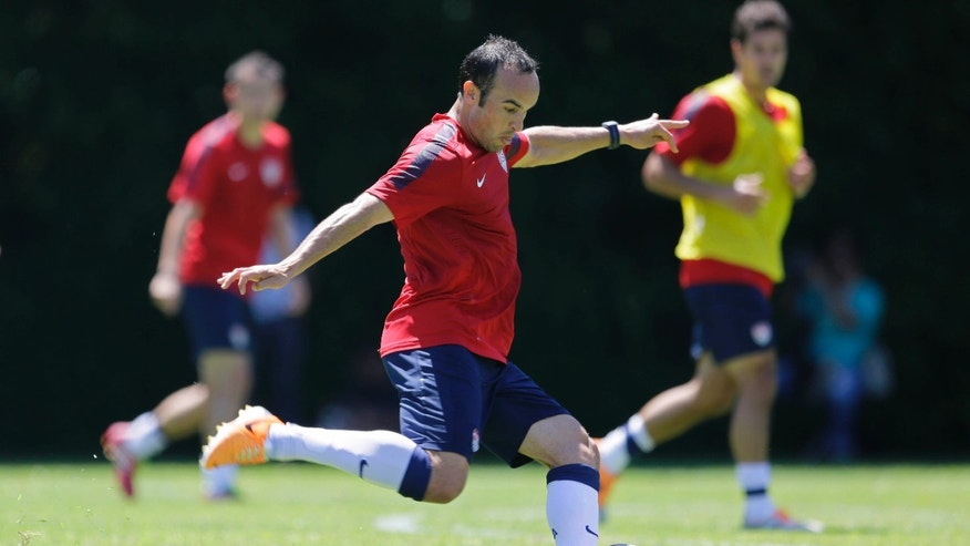 United States' Landon Donovan kicks the ball during a training session in Sao Paulo, Brazil, Wednesday, Jan. 22, 2014. The US national soccer team is on a training program in Sao Paulo preparing for the World Cup tournament, which gets underway on June 12.  (AP Photo/Nelson Antoine)