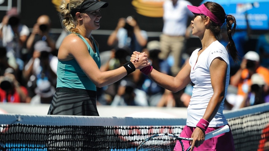 Li Na of China, right,  shakes hands with Eugenie Bouchard of Canada at the net after Li won their semifinal at the Australian Open tennis championship in Melbourne, Australia, Thursday, Jan. 23, 2014.(AP Photo/Andrew Brownbill)