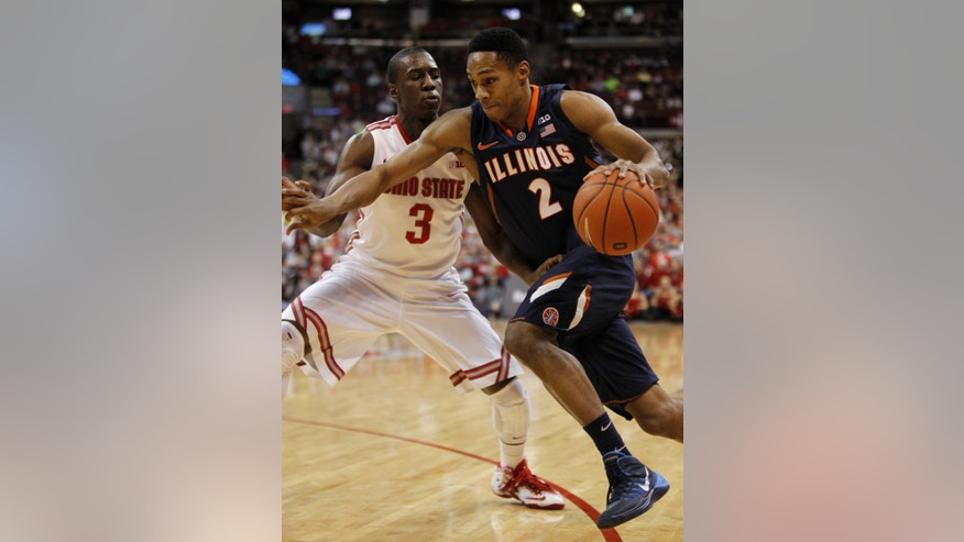 Illinois Joseph Bertrand, right, tries to get around Ohio State's Shannon Scott during the first half of an NCAA college basketball game in Columbus, Ohio, Thursday, Jan. 23, 2014. ( AP Photo/Paul Vernon)