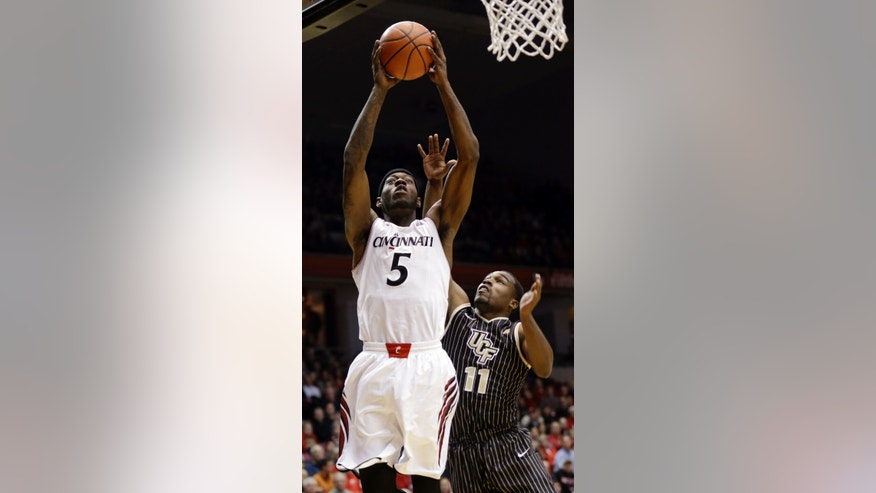 Cincinnati forward Justin Jackson (5) drives against Central Florida guard Calvin Newell (11) in the first half of an NCAA college basketball game, Thursday, Jan. 23, 2014, in Cincinnati. (AP Photo/Al Behrman)