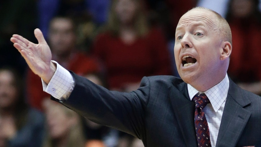 Cincinnati coach Mick Cronin reacts to a call during the first half of an NCAA college basketball game against Central Florida, Thursday, Jan. 23, 2014, in Cincinnati. (AP Photo/Al Behrman)