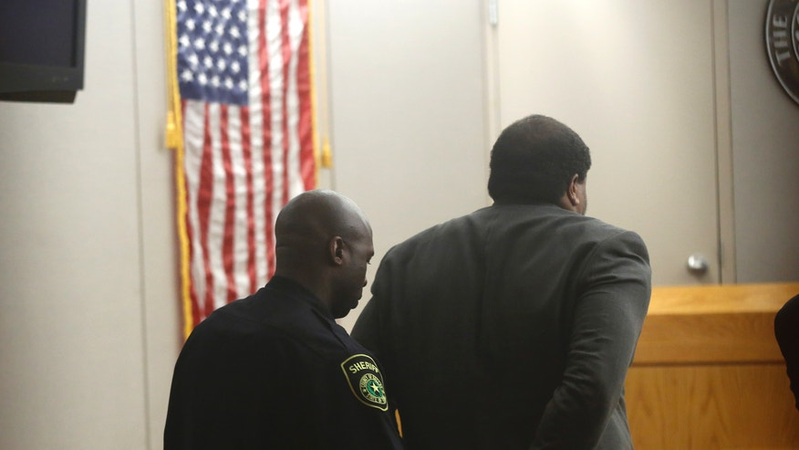 Former Dallas Cowboys NFL football player Josh Brent is put in handcuffs after he was found guilty of intoxication manslaughter Wednesday, Jan. 22, 2014, in Dallas, for a fiery wreck that killed his teammate and close friend, Jerry Brown. He faces up to 20 years in prison for a December 2012 wreck after a night of partying with fellow Cowboys players. He could also get probation. (AP Photo/The Dallas Morning News,  Nathan Hunsinger)  MANDATORY CREDIT; MAGS OUT; TV OUT; INTERNET USE BY AP MEMBERS ONLY; NO SALES