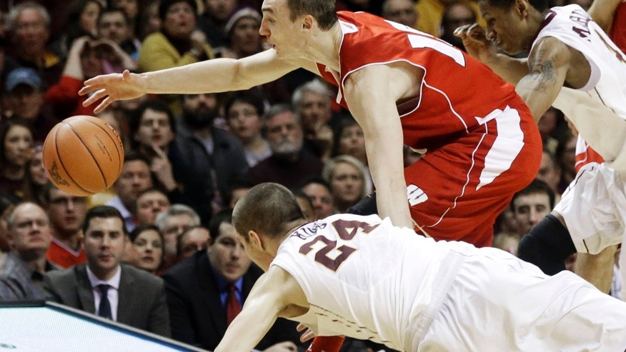 Minnesota's Joey King falls as he and Wisconsin's Sam Dekker, top, scramble for a loose ball during the second half of an NCAA college basketball game, Wednesday, Jan. 22, 2014, in Minneapolis. Minnesota won 81-68. (AP Photo/Jim Mone)