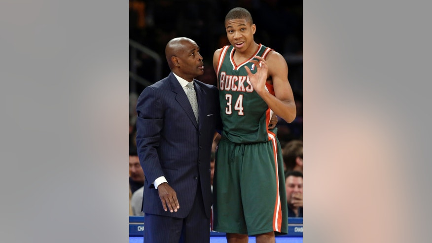 FILE - In this Oct. 30, 2013, file photo, Milwaukee Bucks coach Larry Drew, left, talks to guard Giannis Antetokounmpo during the first half of an NBA basketball game against the New York Knicks in New York. The precocious 19-year-old rookie is providing an unexpected bright spot in an otherwise dismal season for the Bucks. (AP  Photo/Frank Franklin II, File)