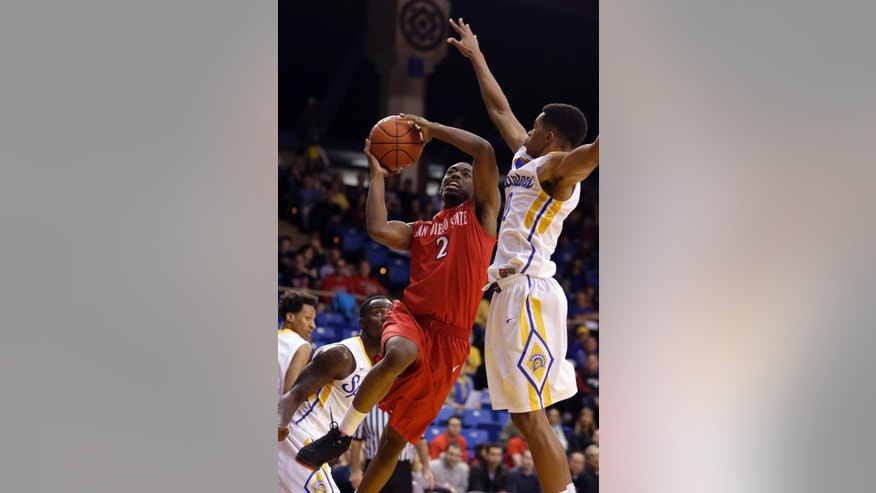 San Diego State's Xavier Thames (2) lays up a shot against San Jose State's Isaac Thornton during the first half of an NCAA college basketball game Wednesday, Jan. 22, 2014, in San Jose, Calif. (AP Photo/Ben Margot)