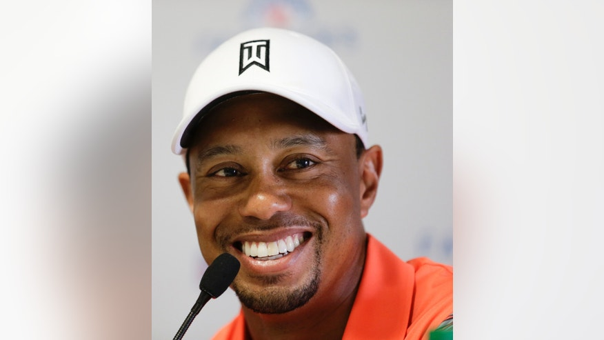 Tiger Woods talks to the media during a news conference at the Farmers Insurance Open golf tournament at Torrey Pines Golf Course on Wednesday, Jan. 22, 2014, in San Diego. (AP Photo/Chris Carlson)
