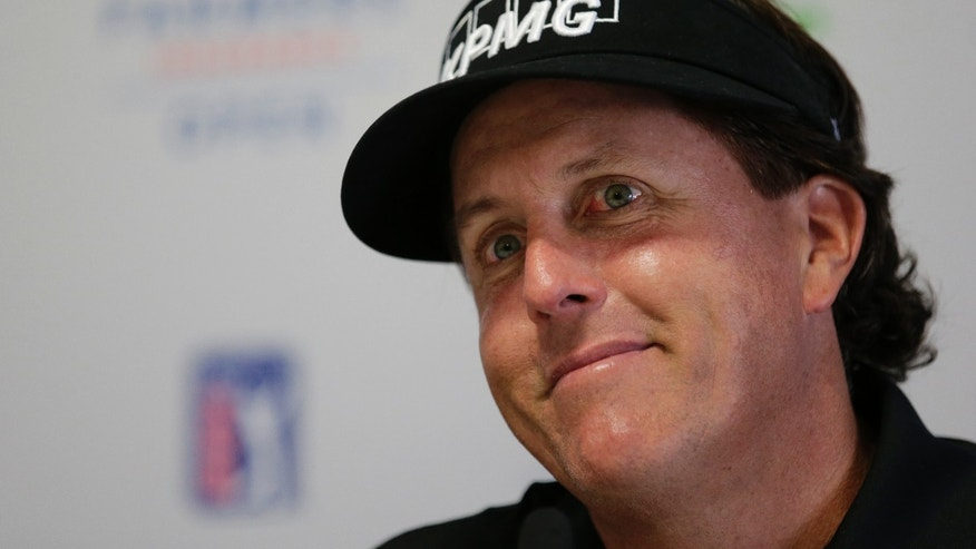 Phil Mickelson smiles during a news conference at Farmers Insurance Open golf tournament at Torrey Pines Golf Course on Wednesday, Jan. 22, 2014, in San Diego. (AP Photo/Chris Carlson)