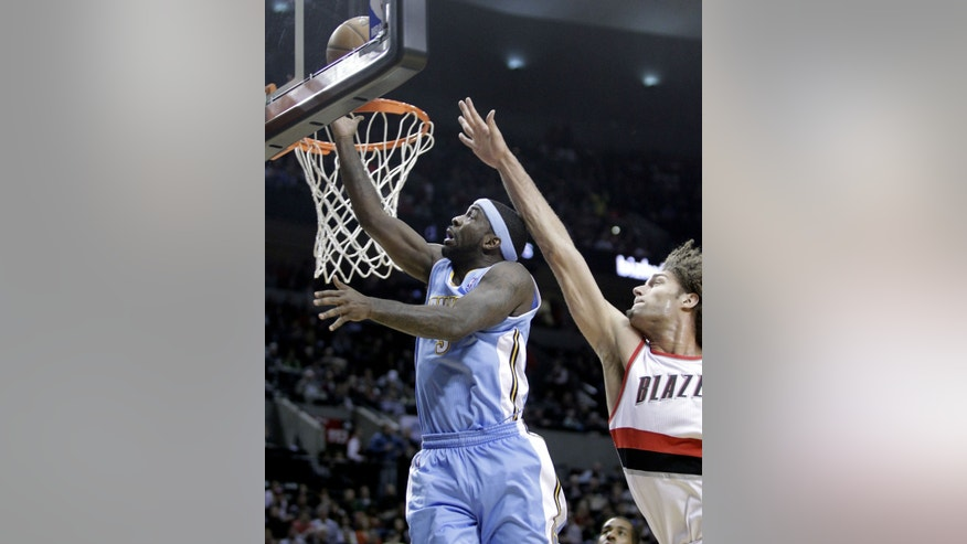 Denver Nuggets guard Ty Lawson, left, goes to the hoop past Portland Trail Blazers center Robin Lopez during the first half of an NBA basketball game in Portland, Ore., Thursday, Jan. 23, 2014. (AP Photo/Don Ryan)