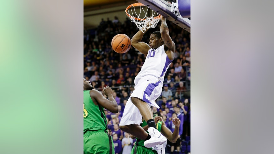 Washington forward Shawn Kemp, Jr., dunks against Oregon in the first half of an NCAA men's college basketball game Thursday, Jan. 23, 2014, in Seattle. (AP Photo/Elaine Thompson)