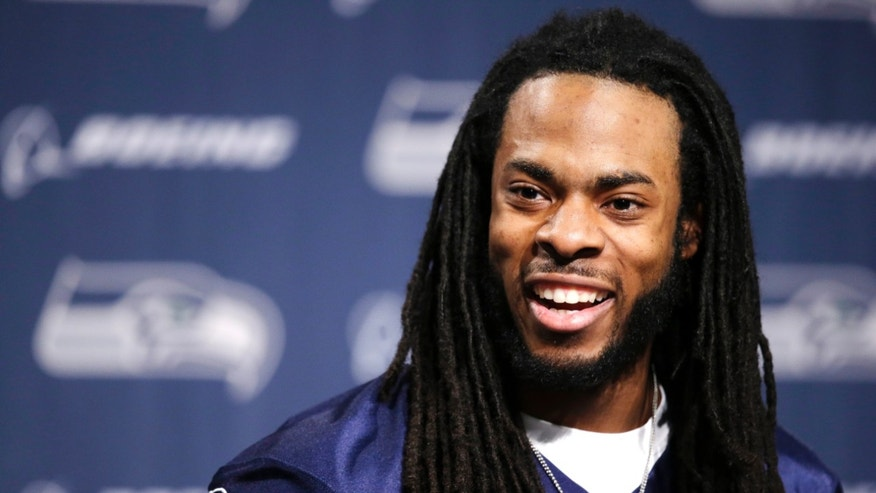 Seattle Seahawks' Richard Sherman speaks at an NFL football news conference Wednesday, Jan. 22, 2014, in Renton, Wash. The Seahawks play the Denver Broncos in the Super Bowl on Feb. 2. (AP Photo/Elaine Thompson)