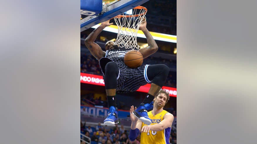 Orlando Magic forward Kyle O'Quinn (2) dunks the ball in front of Los Angeles Lakers center Pau Gasol, right, during the second half of an NBA basketball game in Orlando, Fla., Friday, Jan. 24, 2014. The Magic won 114-105. (AP Photo/Phelan M. Ebenhack)