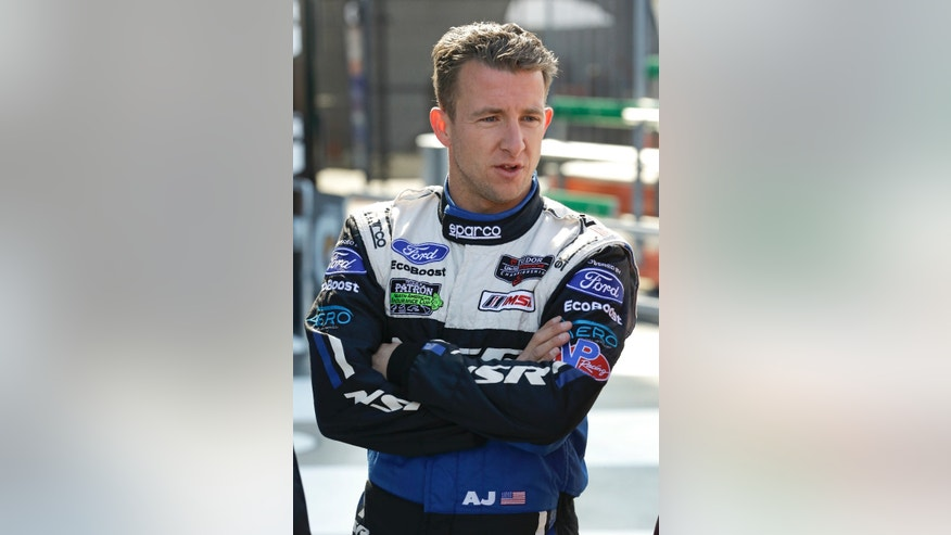 AJ Allmendinger talks with other drivers after a practice session for the IMSA Series Rolex 24 hour auto race at Daytona International Speedway in Daytona Beach, Fla., Friday, Jan. 24, 2014.(AP Photo/John Raoux)
