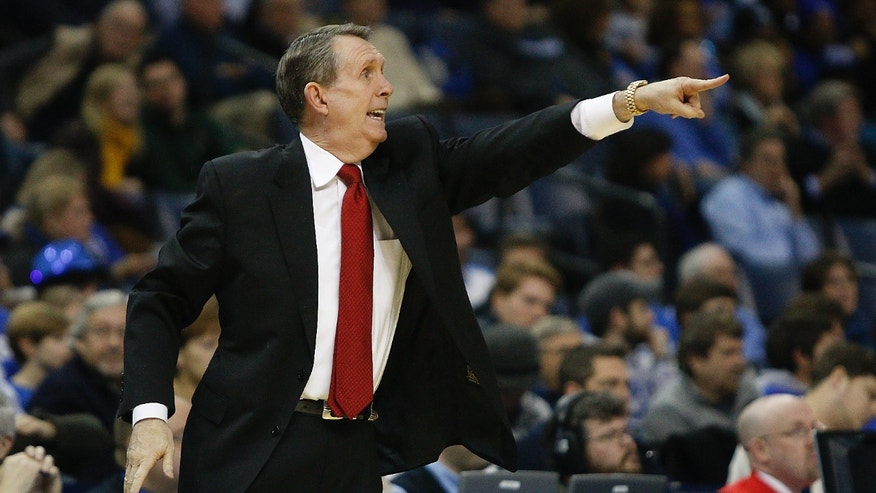 Houston coach James Dickey calls a play against Memphis in the first half of an NCAA college basketball game, Thursday, Jan. 23, 2014, in Memphis, Tenn. (AP Photo/Lance Murphey)