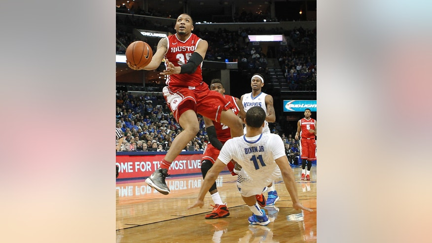 Memphis guard Michael Dixon, Jr. (11) falls backwards as Houston forward Tashawn Thomas (35) drives to the basket in the second half of an NCAA college basketball game, Thursday, Jan. 23, 2014, in Memphis, Tenn. Memphis won 82-59. (AP Photo/Lance Murphey)