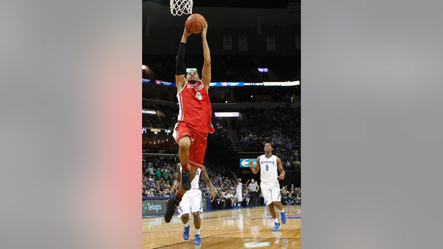 Houston guard LeRon Barnes (4) goes to the basket against Memphis in the second half of an NCAA college basketball game, Thursday, Jan. 23, 2014, in Memphis, Tenn. Memphis won 82-59. (AP Photo/Lance Murphey)