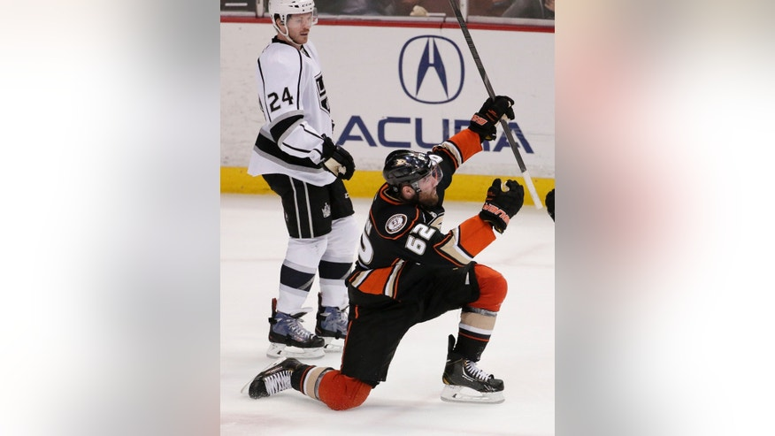 Anaheim Ducks left wing Patrick Maroon, right, celebrates his goal as Los Angeles Kings center Colin Fraser looks on during the second period of an NHL hockey game in Anaheim, Calif., Thursday, Jan. 23, 2014. (AP Photo/Chris Carlson)