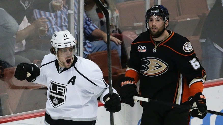 Los Angeles Kings center Anze Kopitar, left, celebrates his goal as Anaheim Ducks left wing Patrick Maroon look on during the first period of an NHL hockey game in Anaheim, Calif., Thursday, Jan. 23, 2014. (AP Photo/Chris Carlson)