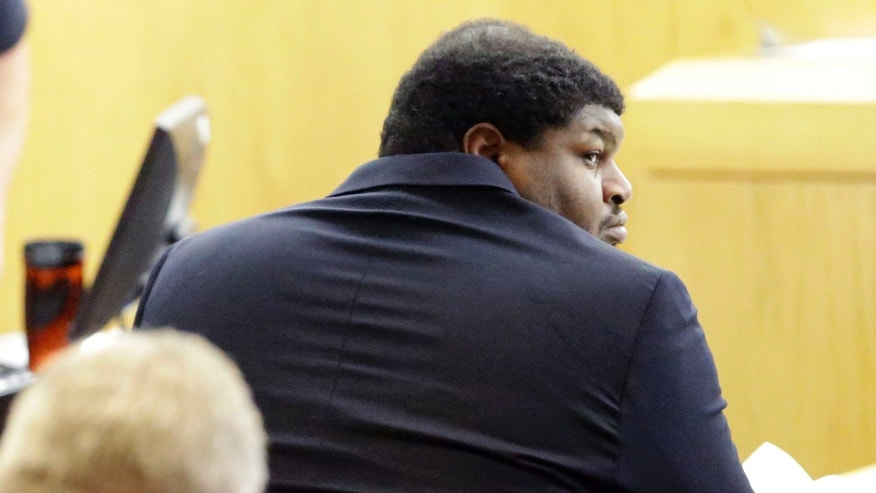 Former Dallas Cowboys Josh Brent looks around in court during the penalty phase of the intoxication manslaughter trial in Dallas, Thursday, Jan. 23, 2014.  Brent was found guilty on Wednesday, of intoxication manslaughter and faces probation to 20 years for a fiery wreck that killed his teammate and close friend Jerry Brown. (AP Photo/LM Otero)