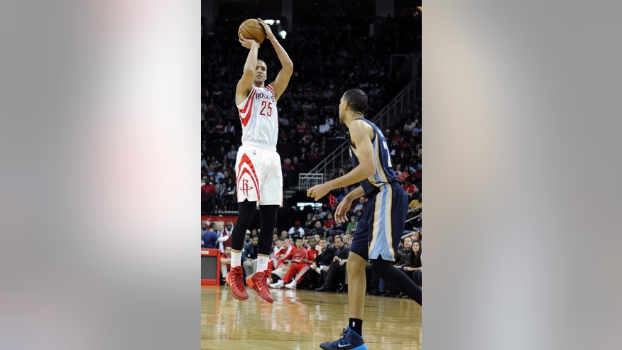 Houston Rockets' Chandler Parsons (25) shoots for one of the 10 three-point shots he made in the second half as Memphis Grizzlies' Tayshaun Prince watches during an NBA basketball game Friday, Jan. 24, 2014, in Houston. The Grizzlies won 88-87. (AP Photo/Pat Sullivan)