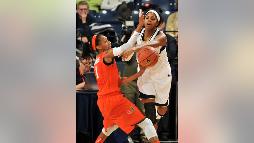 Notre Dame forward Ariel Braker blocks a pass from Miami guard Caprice Dennis, left, during the first half of an NCAA college basketball game, Thursday, Jan. 23, 2014 in South Bend, Ind. (AP Photo/Joe Raymond)