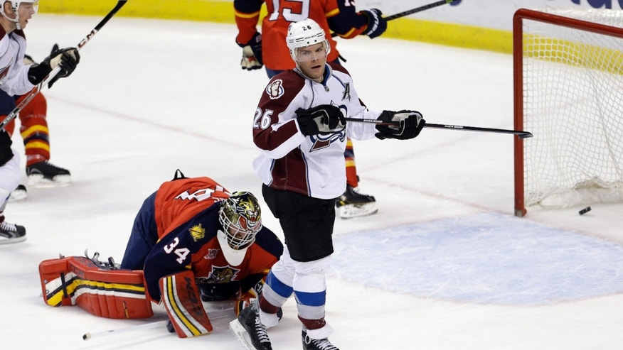 Colorado Avalanche center Paul Stastny (26) scores a goal against Florida Panthers goalie Tim Thomas (34) during the first period of an NHL hockey game in Sunrise, Fla., Friday, Jan. 24, 2014. (AP Photo/Alan Diaz)