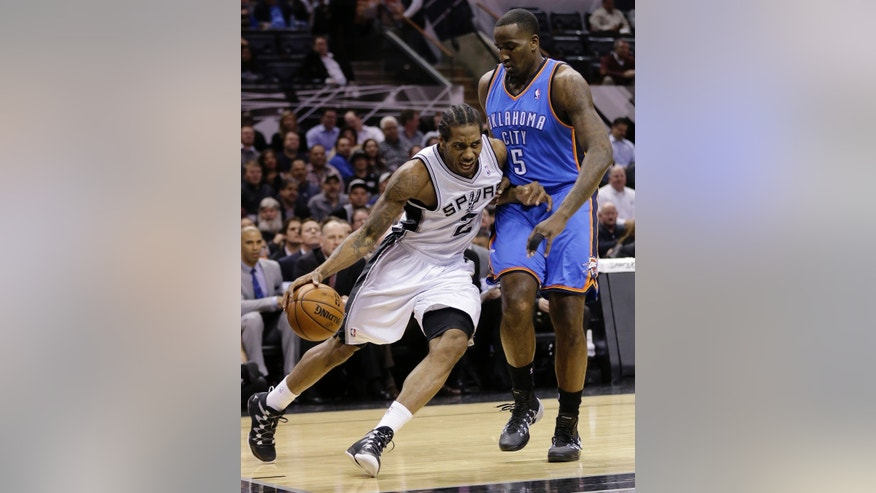 San Antonio Spurs' Kawhi Leonard (2) drives around Oklahoma City Thunder's Kendrick Perkins (5) during the first half of an NBA basketball game, Wednesday, Jan. 22, 2014, in San Antonio. The Thunder won 111-105. (AP Photo/Eric Gay)