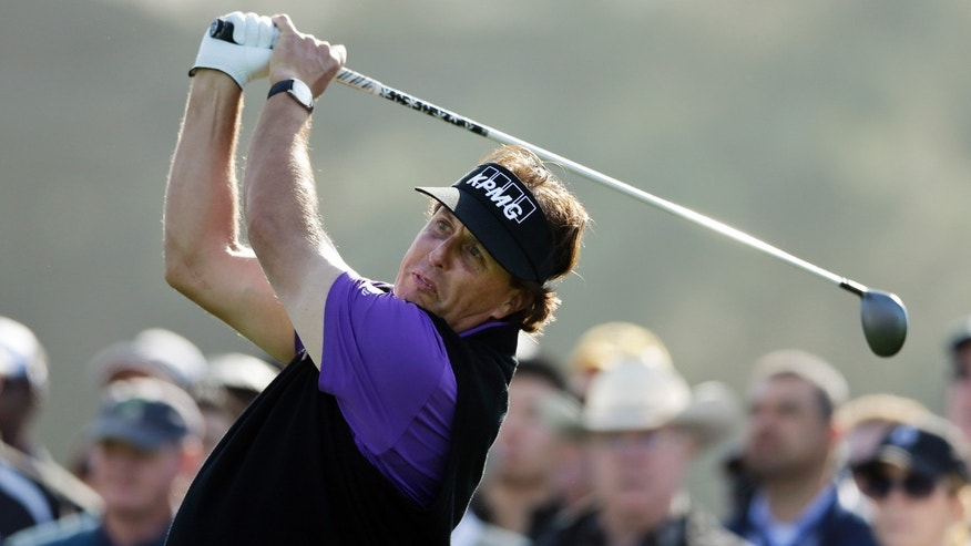 Phil Mickelson hits his tee shot on the 10th hole of the north course during the first round of the Farmers Insurance Open golf tournament Thursday, Jan. 23, 2014, in San Diego. (AP Photo/Gregory Bull)