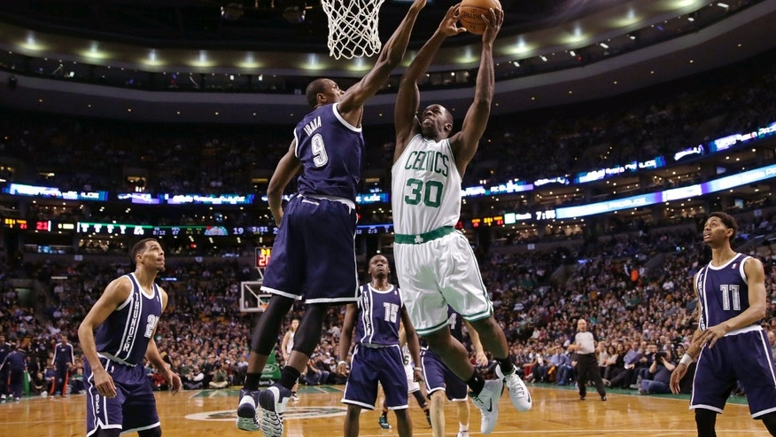 Boston Celtics forward Brandon Bass (30) drives to the basket against Oklahoma City Thunder forward Serge Ibaka (9) during the first half of an NBA basketball game in Boston, Friday, Jan. 24, 2014. (AP Photo/Charles Krupa)