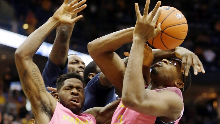 Marquette's Chris Otule, right, grabs a rebound against Villanova during the first half of an NCAA college basketball game Saturday, Jan. 25, 2014, in Milwaukee. (AP Photo/Jeffrey Phelps)