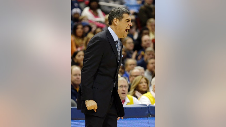 Villanova coach Jay Wright shouts instruction to his team during the first half of an NCAA college basketball game against Marquette Saturday, Jan. 25, 2014, in Milwaukee. (AP Photo/Jeffrey Phelps)