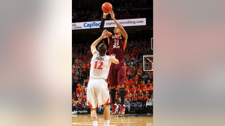 Virginia Tech's Jarell Eddie (31) shoots over Virginia guard Joe Harris (12) during an NCAA college basketball game Saturday, Jan. 25, 2014, in Charlottesville, Va. (AP Photo/The Daily Progress, Andrew Shurtleff)