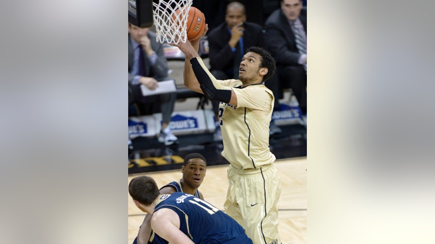 Wake Forest orward Devin Thomas (2) shoots over Notre Dame center Garrick Sherman (11) during the first half of an NCAA college basketball game at the Joel Coliseum in Winston-Salem, N.C., Saturday, Jan. 25, 2014. (AP Photo/The Winston-Salem Journal, Bruce Chapman)