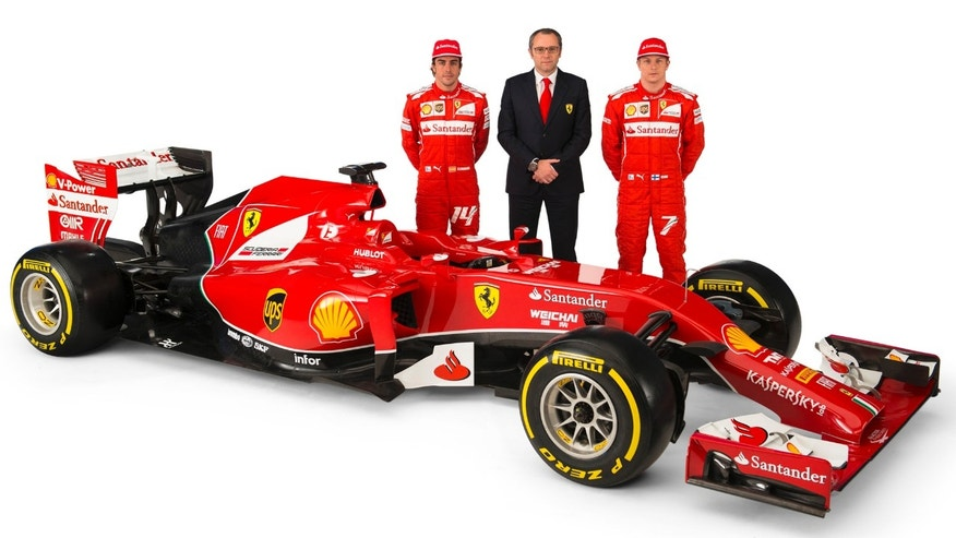 In this photo made available by Ferrari Media Saturday, Jan. 25, 2014,  Ferrari team principal Stefano Domenicali, center, poses with drivers Fernando Alonso, left, and Kimi Raikkonen near the new Ferrari F14 T Formula One car during the official presentation in Maranello, Italy. (AP Photo/Ferrari Photoservice)