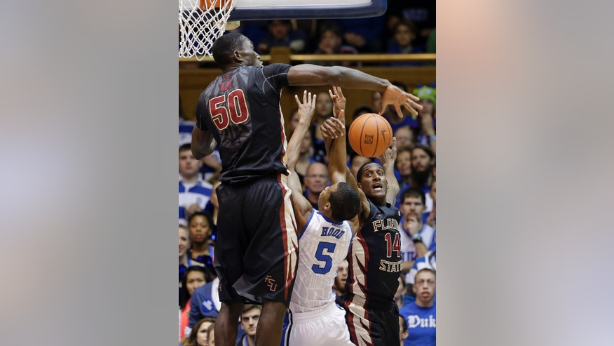 Duke's Rodney Hood (5) tries to shoot as Florida State's Michael Ojo (50) and Robert Gilchrist (14) defend during the first half of an NCAA college basketball game in Durham, N.C., Saturday, Jan. 25, 2014. (AP Photo/Gerry Broome)
