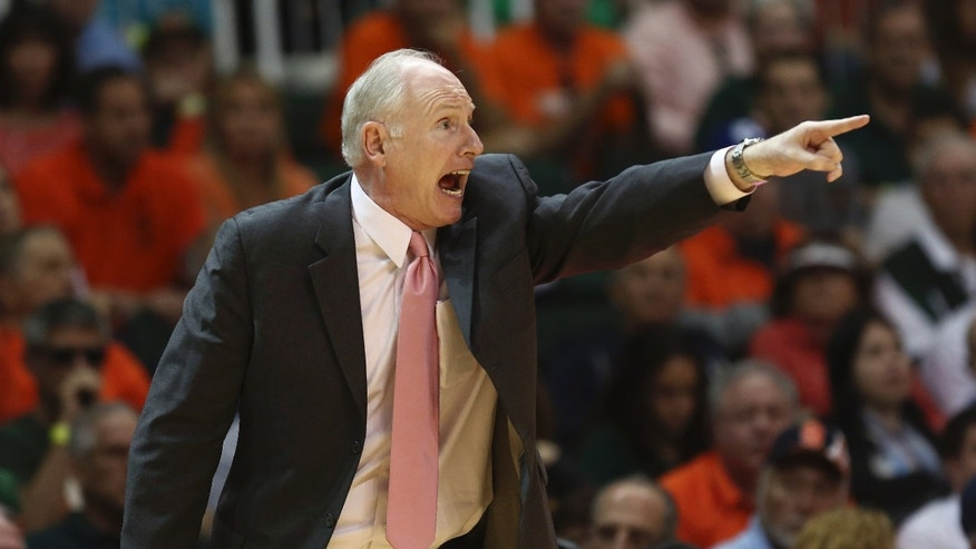 Miami coach Jim Larranaga shouts during the second half of a NCAA college basketball game against Syracuse  in Coral Gables, Fla., Saturday, Jan. 25, 2014. (AP Photo/J Pat Carter)