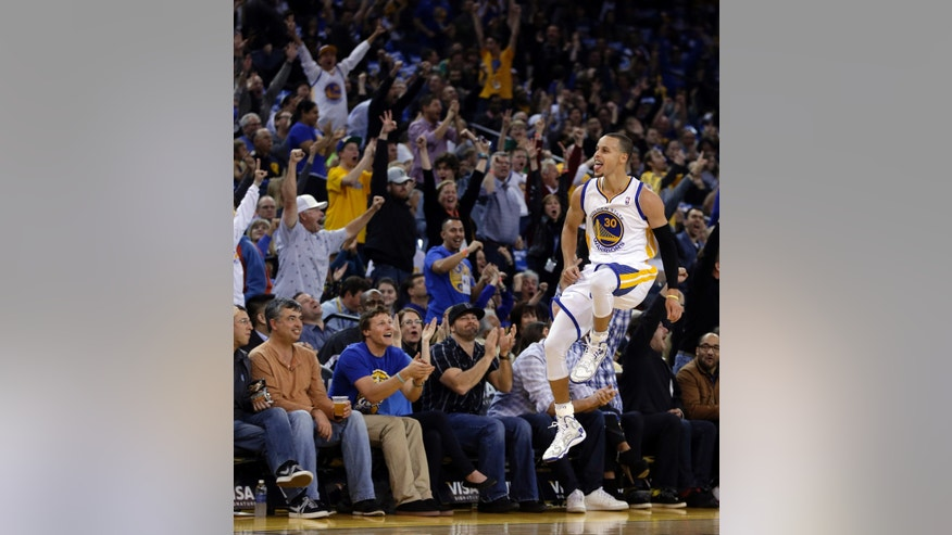 Golden State Warriors' Stephen Curry (30) celebrates after scoring against the Minnesota Timberwolves during the first half of an NBA basketball game Friday, Jan. 24, 2014, in Oakland, Calif. (AP Photo/Ben Margot)