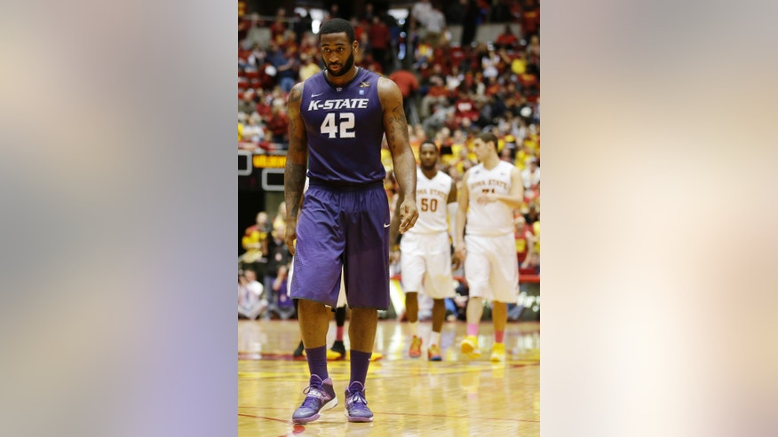 Kansas State forward Thomas Gipson (42) walks up court during the second half of an NCAA college basketball game against Iowa State, Saturday, Jan. 25, 2014, in Ames, Iowa.  Iowa State won 81-75. (AP Photo/Charlie Neibergall)
