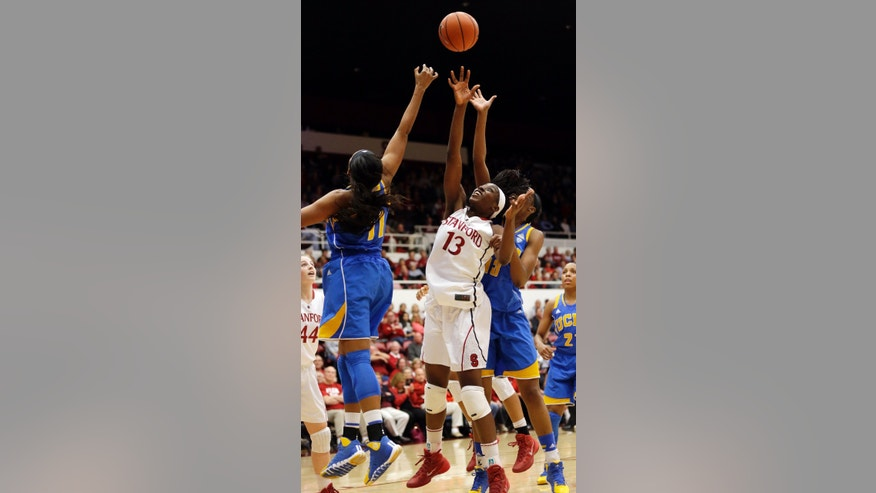 Stanford 's Chiney Ogwumike (13) reaches for a rebound against UCLA's Atonye Nyingifa, left, during the first half of an NCAA college basketball game on Friday, Jan. 24, 2014, in Stanford, Calif. (AP Photo/Marcio Jose Sanchez)