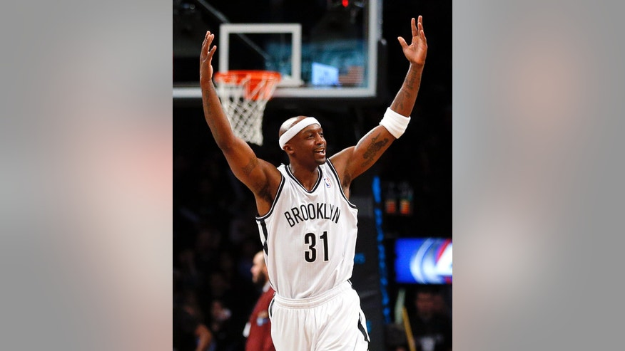 Brooklyn Nets shooting guard Jason Terry (31) runs upcourt celebrating a three point shot by teammate Mirza Teletovic in the second quarter of an NBA basketball game against the Dallas Mavericks on Friday, Jan. 24, 2014, in New York. (AP Photo/Paul J. Bereswill)
